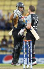 Ross Taylor, left, greets teammate Brendon McCullum