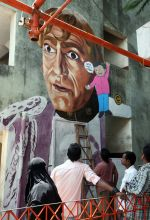 Artist looking at Amrish Puri graffiti