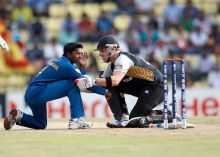 New Zealand's Brendon McCullum (right) and Akila Dananjaya
