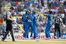 Sri Lankan players celebrate the wicket of Brendon McCullum