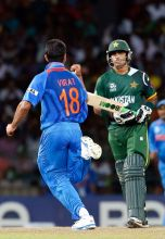 Virat Kohli, left, celebrates the dismissal of Pakistan's batsman Mohammad Hafeez