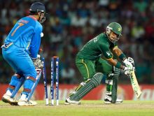 Mohammad Hafeez (right) with MS Dhoni