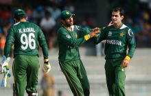 Mohammad Hafeez (right) with teammates