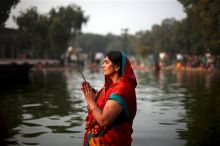 Woman perform rituals during Chhat Puja