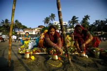 Devotees perform rituals at sunset