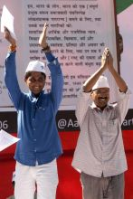 Arvind Kejriwal (right)