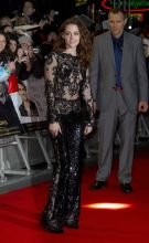Kristen Stewart chose to wear jaw-dropping sparkly revealing jumpsuit in black for the London premiere of Twilight: Breaking Dawn Part 2.