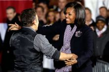 Singer Bruce Springsteen greets first lady Michelle Obama