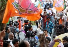 Supporters celebrate Narendra Modi's win