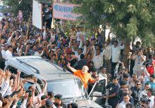 Narendra Modi greets his supporters