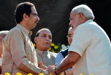 Uddhav Thackeray (left) and Narendra Modi