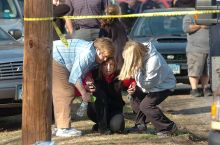 People are comforted near Sandy Hook Elementary School after a gunman opened fire inside the school.