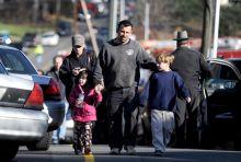 Parents meet their children at the Sandy Hook Elementary School in Newtown
