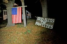 Connecticut neighbors hoisted an American flag and created a make-shift prayer for the deceased.