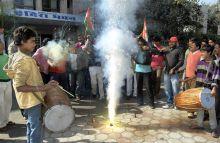 Youth Congress workers celebrate hanging of Afzal Guru