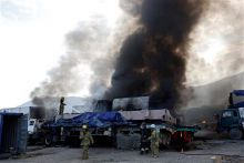 Firefighters at the attack site in Afghanistan