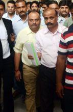 Sudhir Sharma (Centre)