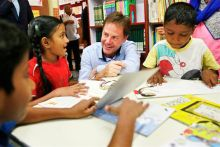 Britain's Deputy Prime Minister Nick Clegg interacts with children