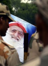 Asaram Bapu supporter holds a placard