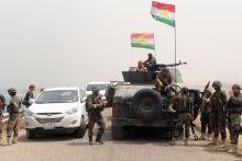Kurdish fighters stand guard in Mosul