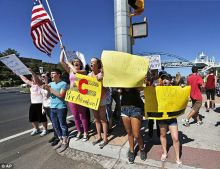 Students line a busy intersection protesting against a Jefferson County School Board proposal