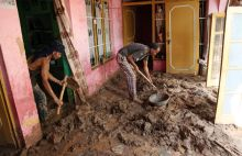People are removing mud from their house
