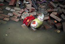 A doll lies on bricks