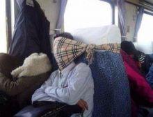 Passenger sleeping in a train