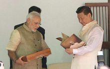 PM Narendra Modi and Xi Jinping at Sabarmati Ashram on Wednesday.