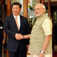 Prime Minister Narendra Modi shakes hand with Chinese President Xi Jinping