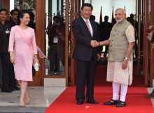 Prime Minister Narendra Modi, poses with Chinese President Xi Jinping and Xi's wife Peng Liyuan