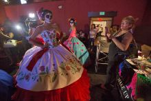 Models pose for camera at Day of the Dead festival at Hollywood.