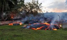 The slow-moving lava near a property boundary