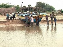 Fishermen shift their boat in the view of cyclonic storm Hudhud in Srikakulam.