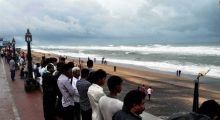 Onlookers looking at sea tide at Gopalpur beach