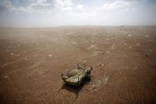 cradle left behind by Syrian Kurdish refugees
