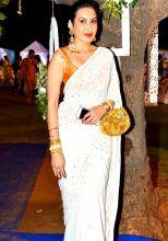 Kamya Punjabi looked classy in her white-orange-gold saree.