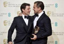 Tom Cruise (L) and Leonardo DiCaprio at BAFTA Awards