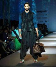 A model sashays down the ramp for designer Divyam Mehta.