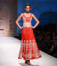 A model walks the ramp for designer Niki Mahajan. Her collection had lots of red, yellows and beige.