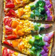 Using tomatoes, squash, corn, capsicum, broccoli and onion to bring out the rainbow in your pizzas is a great idea!
