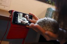 A woman takes a selfie with a hedgehog at the Harry hedgehog cafe.