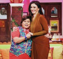 Bharti Singh and Tabu enjoy a light moment on the sets.