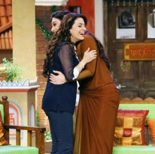 Juhi and Tabu hug on the sets of Comedy Nights Live.