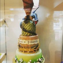 Drogon sits atop this towering three-tier cake. You can just imagine a blast of fire singeing you as the dragon screeches for his Mother.