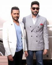Abhishek Bachchan and Riteish Deshmukh look bored while posing for shutterbugs.