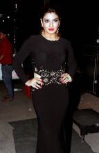 Raveena Tandon looks ravishing in her black outfit and red lipstick.