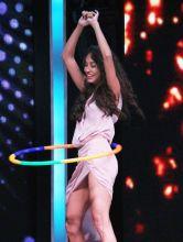 Lisa Haydon having fun with hula hoop.