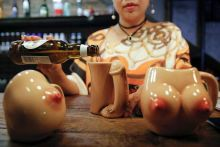 27-year-old Lu Lu, the owner of Ke'er restaurant (Shell in English), pours a drink into a penis-shaped cup at her restaurant in Beijing, China. A report in Reuters quotes her saying that she plans to 'ramp up the kinkiness by putting women customers in h
