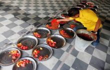 A Muslim man prepares plates of food for an Iftar (breaking of fast) meal inside a mosque on the first day of Ramazan in Kolkata, India.